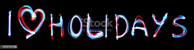istock I love holidays glowing inscription with neon lights backgrorund. 1070722730