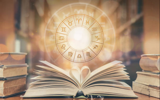 love horoscope, zodiac sign astrology for foretell and fortune telling education study course concept with horoscopic wheel over old love story book in school library - astrologia imagens e fotografias de stock