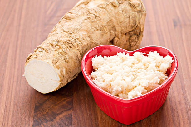 "I Love Horseradish ""A high angle close up of a red heart shaped bowl with freshly made horseradish in the foreground and a portion of the root from which the condiment was made. Horseradish goes good with prime rib, corned beef and other meats. Shot on a wooden background."" horseradish stock pictures, royalty-free photos & images"