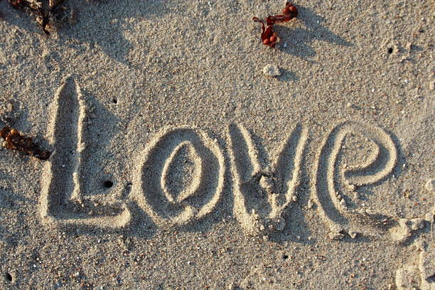 Love in sand - word of emotion  pejft stock pictures, royalty-free photos & images