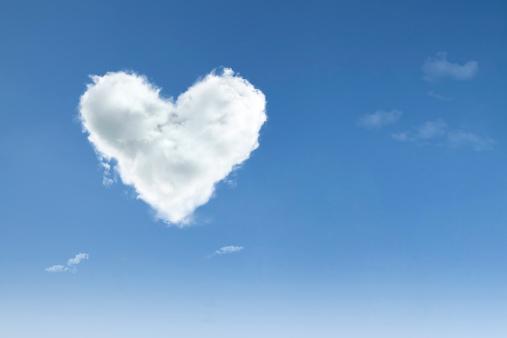Love cloud with heart shape floating on blue sky