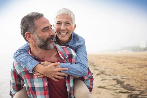 Mature playful couple at beach