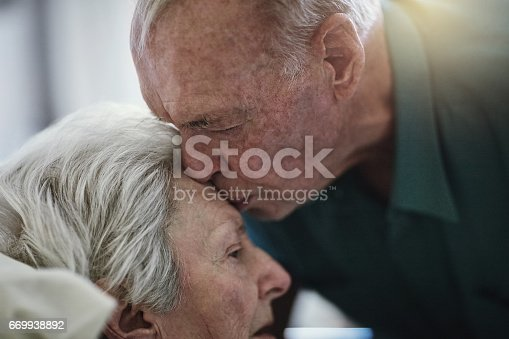 Shot of a senior man visiting his wife in hospital
