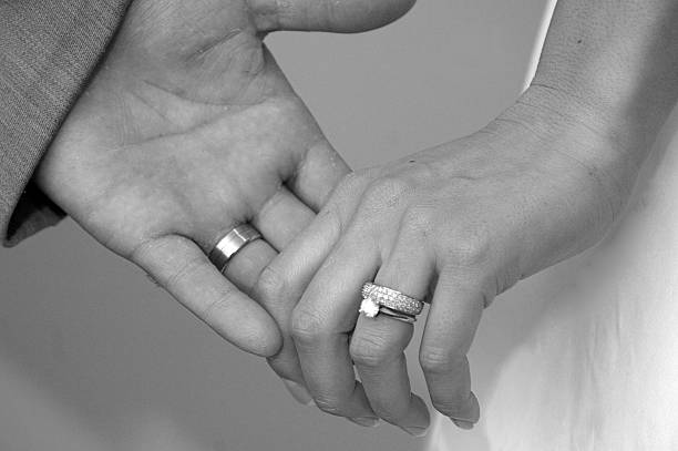 love is forever - diamond ring hand stock photos and pictures