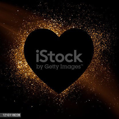 Heart silhouette over gold sparkles.