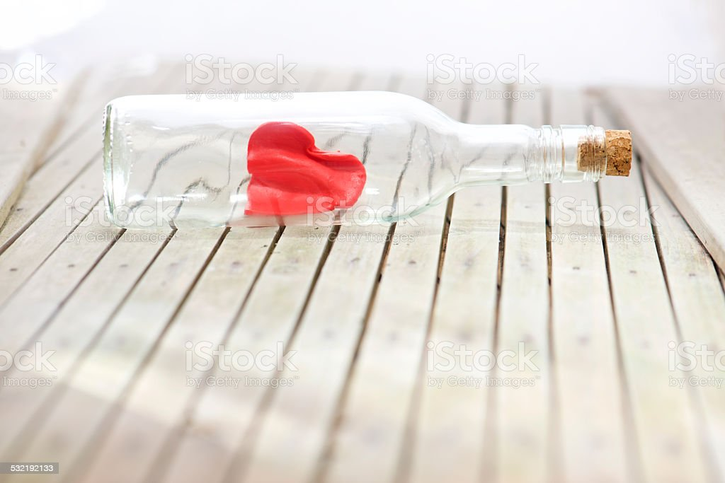 Love is in the bottle red heart stock photo