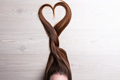 long hair forming a tress ending with a shape of heart