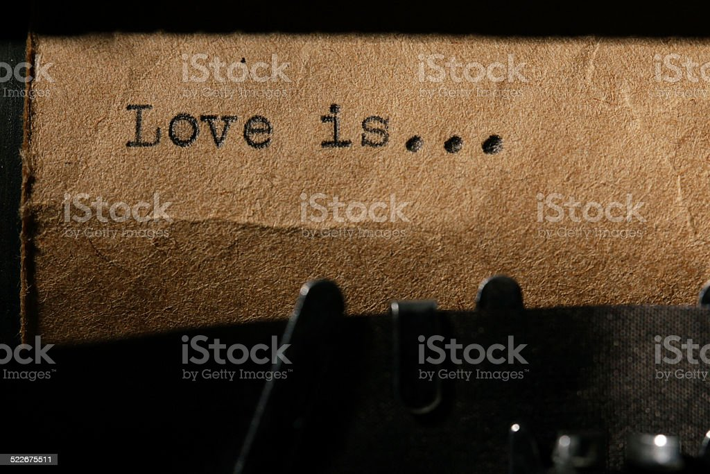 love is, the inscription on a typewriter stock photo