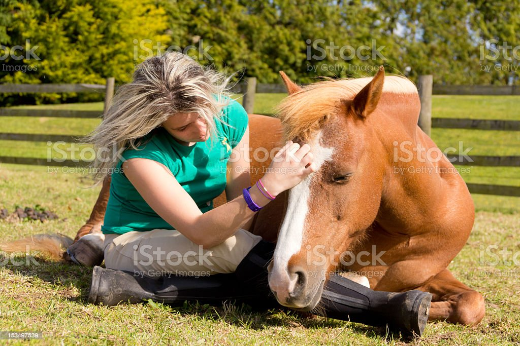 Love is-close up emotional moment between girl and horse. stock photo