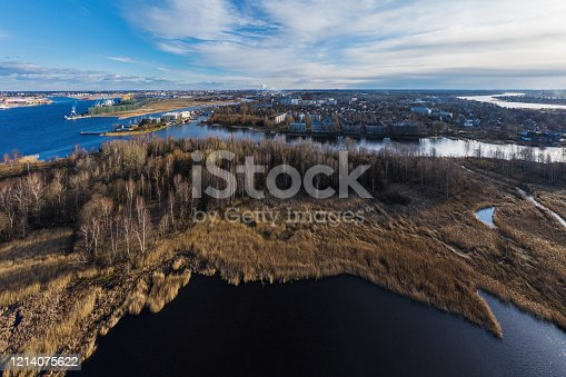 Panoramic view from a high vantage point of a flying drone from the side of river Bullupe river towards Bolderaja