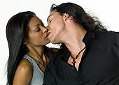 native american young man kissing an afro caribbean young woman on white background (this picture have been shot with a Hasselblad HD3 II 31 megapixels)