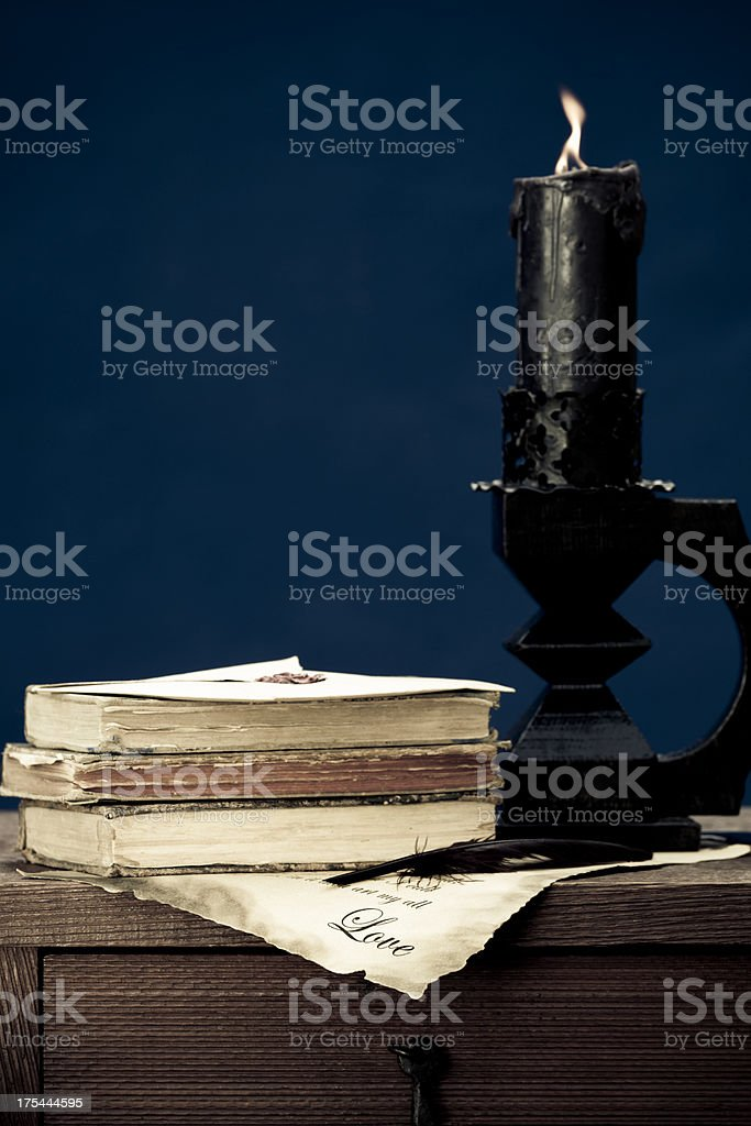 love letter with old books and candle royalty-free stock photo