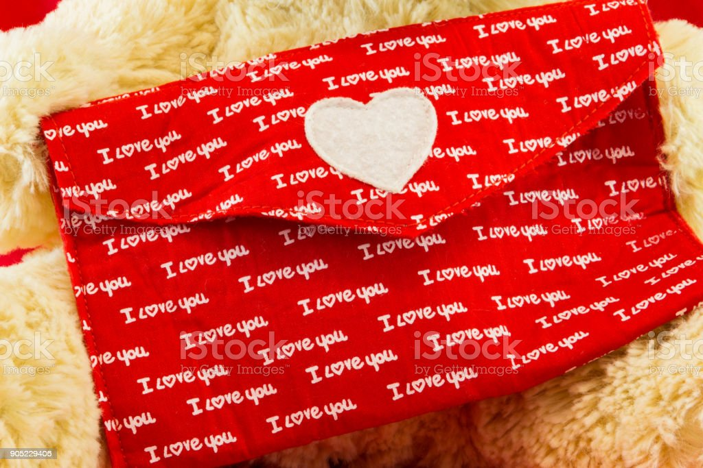 Love letter with red envelop and the word I love You on yellow plushes stock photo