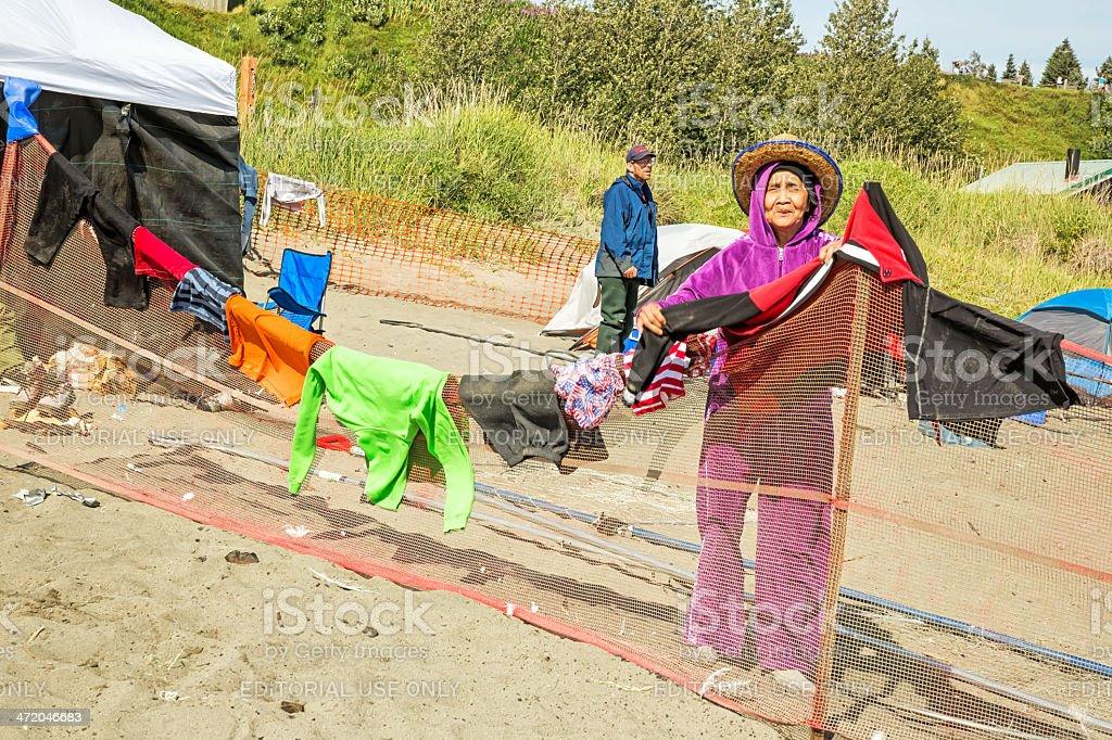 Love Local:  Alaskan Inuit hangs  dip net fishermen's wet clothing stock photo