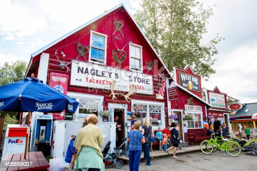 Talkeetn, Alaska, USA - July 26, 2013: Tourist are shopping,eating and just hanging out in the laid back town of Talkeetn in Denali. It is a quaint one street full service town including shops, restaurants including Twister creek and Denali Brewing company.