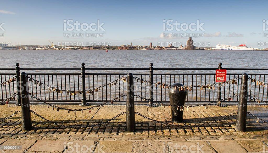 Love locks beside the River Mersey stock photo