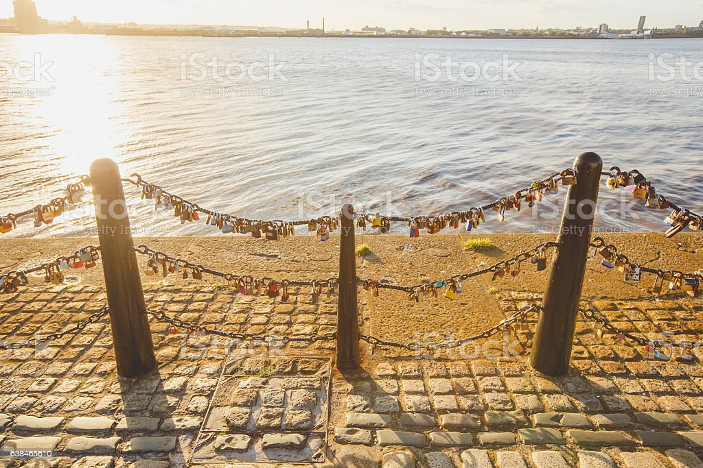 Love locks beside the River Mersey stock photo
