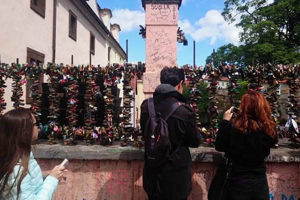 Love locks hang on a bridge in Prague, representing safe friendship and romance in Prague stock photo