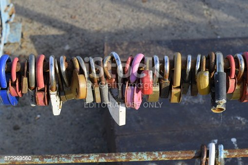 istock Love locks hung by newlyweds and lovers on the fence near the river. A symbol of strong relationships and eternal love 872969560