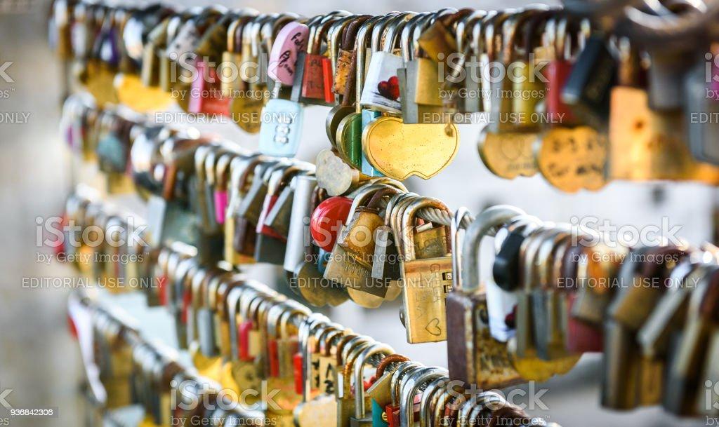 Love locks on the butchers bridge in Ljubljana Slovenia. Bridge full of colorful love padlocks hanging from fence with names written on it. Mesarski most, Ljubljana, Slovenia. stock photo