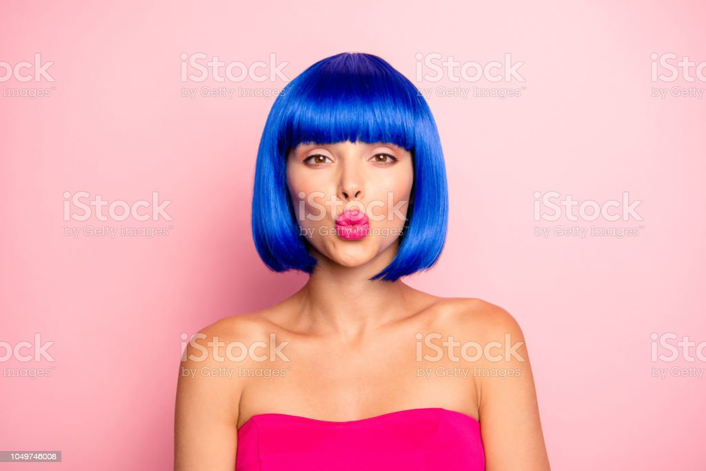 Love, lover concept. Portrait of charming, lovely, cute, sweet, gorgeous woman with vivid, shine modern hairdo isolated on pastel pink background send kiss stock photo