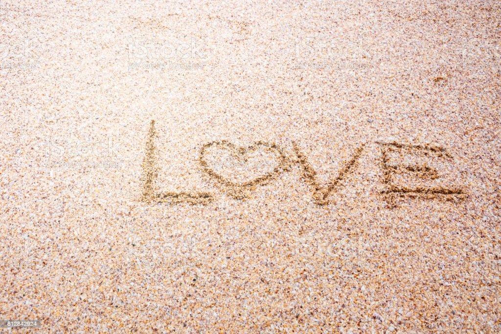 love message written in sand, Sign Love on sand on beach stock photo
