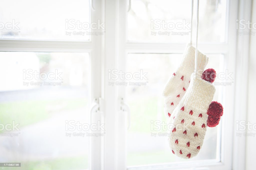 Love mittens hanging by the window stock photo