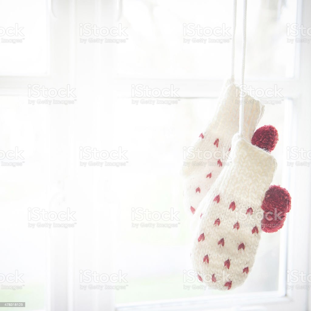 Love mittens hanging by the window Handcrafted love mittens hung by the window Art And Craft Stock Photo