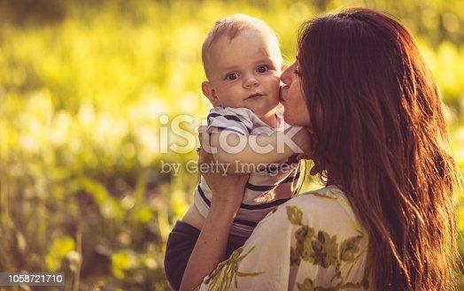 525959168 istock photo I love Mom's kisses. 1058721710