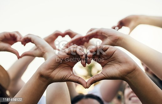 Cropped shot of a group of unrecognizable people forming a hearts with their hands