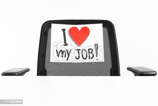 465474428 istock photo I love my job concept. Sign with a heart hanging on a chair with empty desk and white background. Empty space for text. 1174030689
