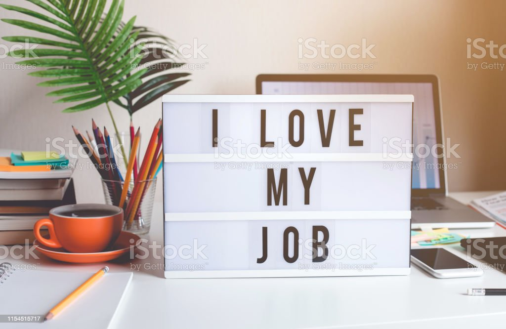 I love my job concepts with text on light box on desk table in home office I love my job concepts with text on light box on desk table in home office.Business motivation or inspiration,performance of human concepts ideas Achievement Stock Photo