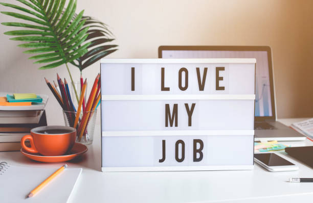 I love my job concepts with text on light box on desk table in home office I love my job concepts with text on light box on desk table in home office.Business motivation or inspiration,performance of human concepts ideas amor stock pictures, royalty-free photos & images