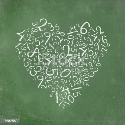istock Love of mathematics: heart shaped simple numbers on school-board texture. 176825822