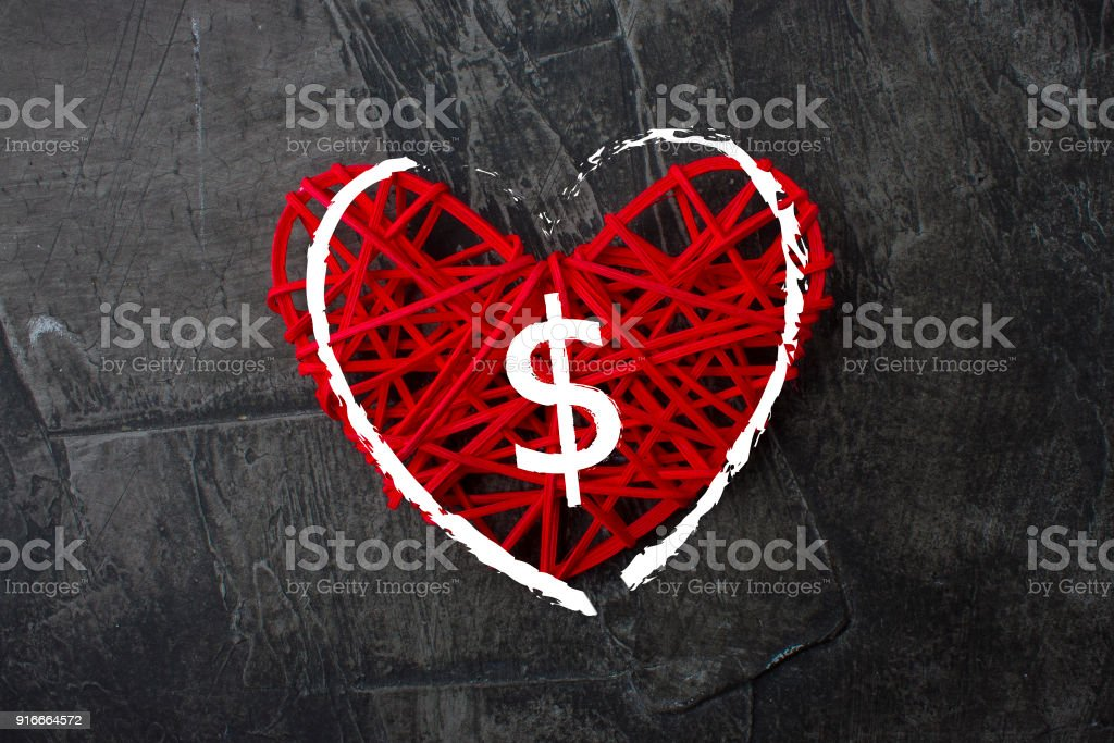 Love of money. A dollar sign on a red heart. Love theme stock photo