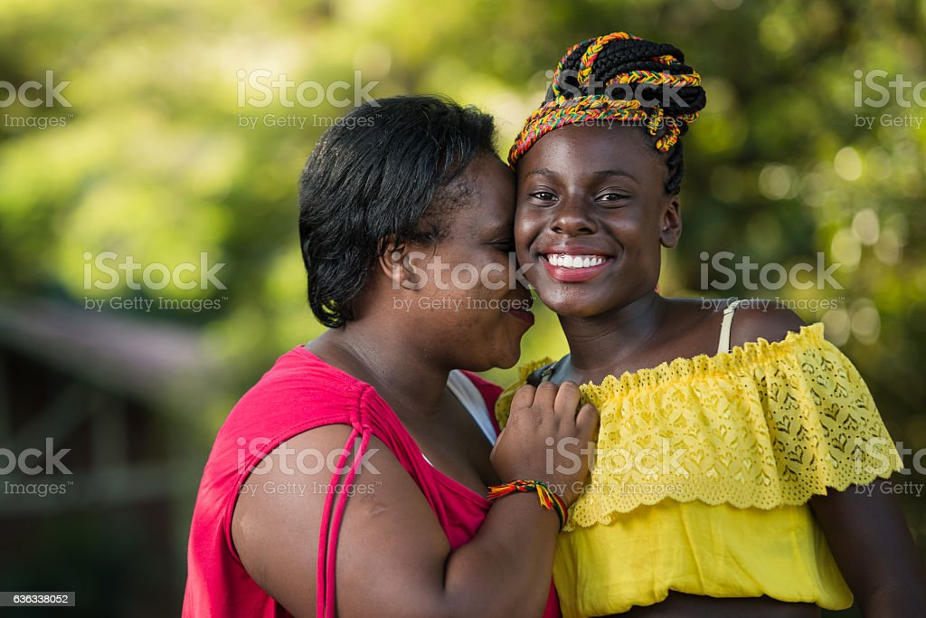 Love of mother, affection his smiling daughter stock photo