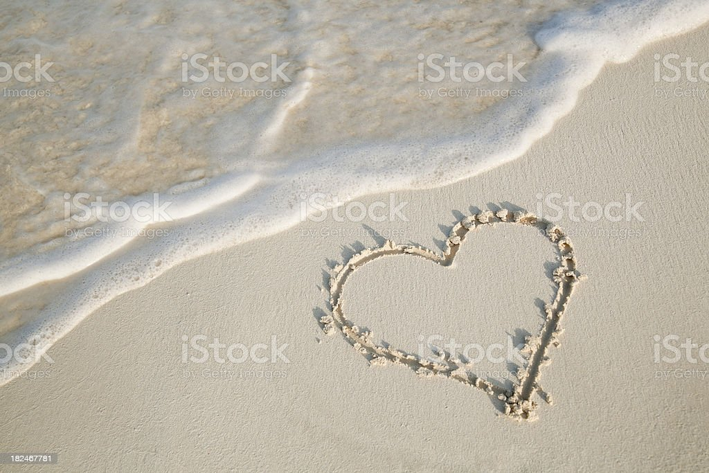 Love on the Beach—Heart Drawn in Sand stock photo