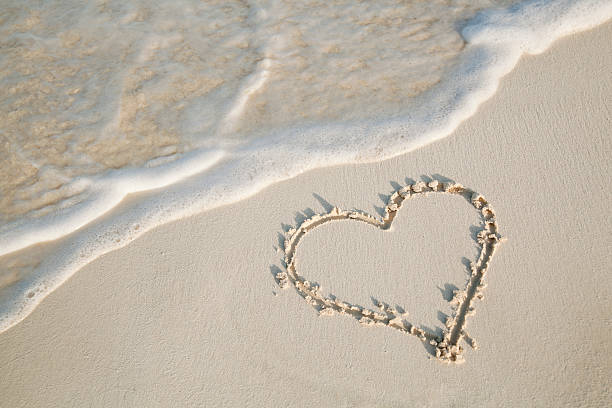 Royalty Free Heart In Sand Pictures Images and Stock