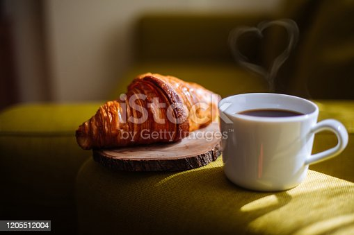 Love on the cup of coffee and croissant