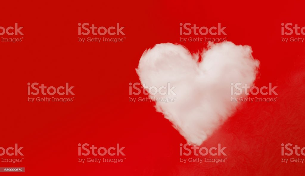 Love on the Red - Heart shaped cloud on red stock photo