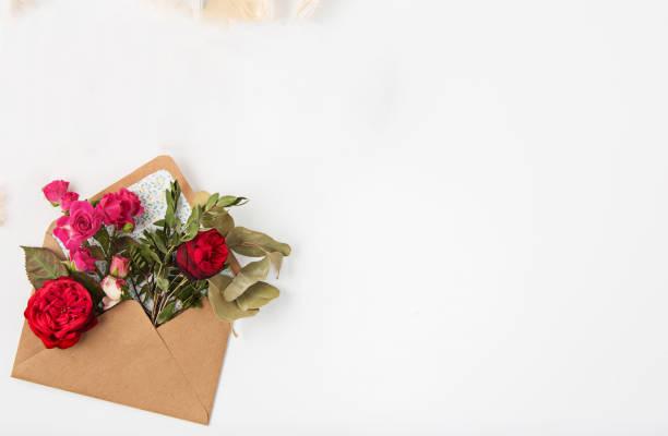 Love or valentines day concept red beautiful roses in envelopen picture id670845486?b=1&k=6&m=670845486&s=612x612&w=0&h=dekgh12kp tdb88ckympw8ervldiopiawvwioft3pk4=