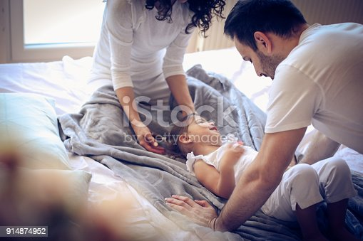479612990istockphoto Love our little girl. Two young parents. 914874952