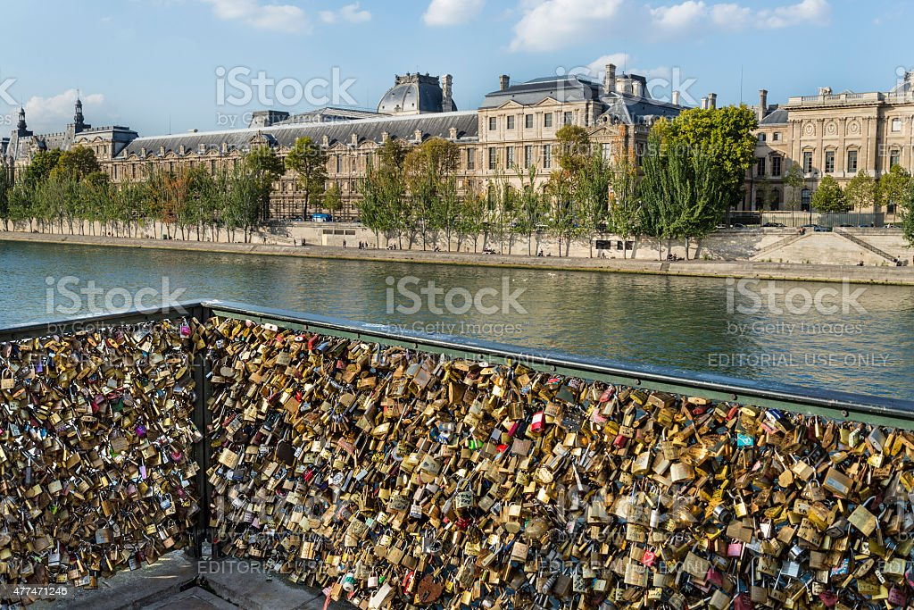 Love padlock frenzy with Louvre museum in the background stock photo