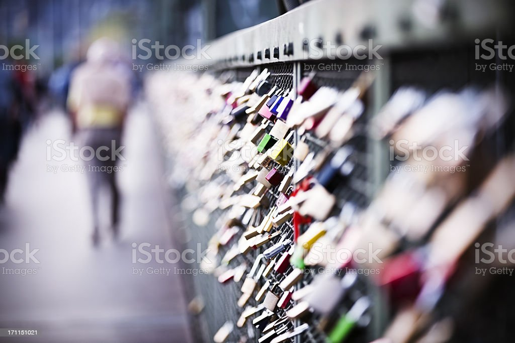 Love padlocks on rail bridge over Rhine in Cologne royalty-free stock photo