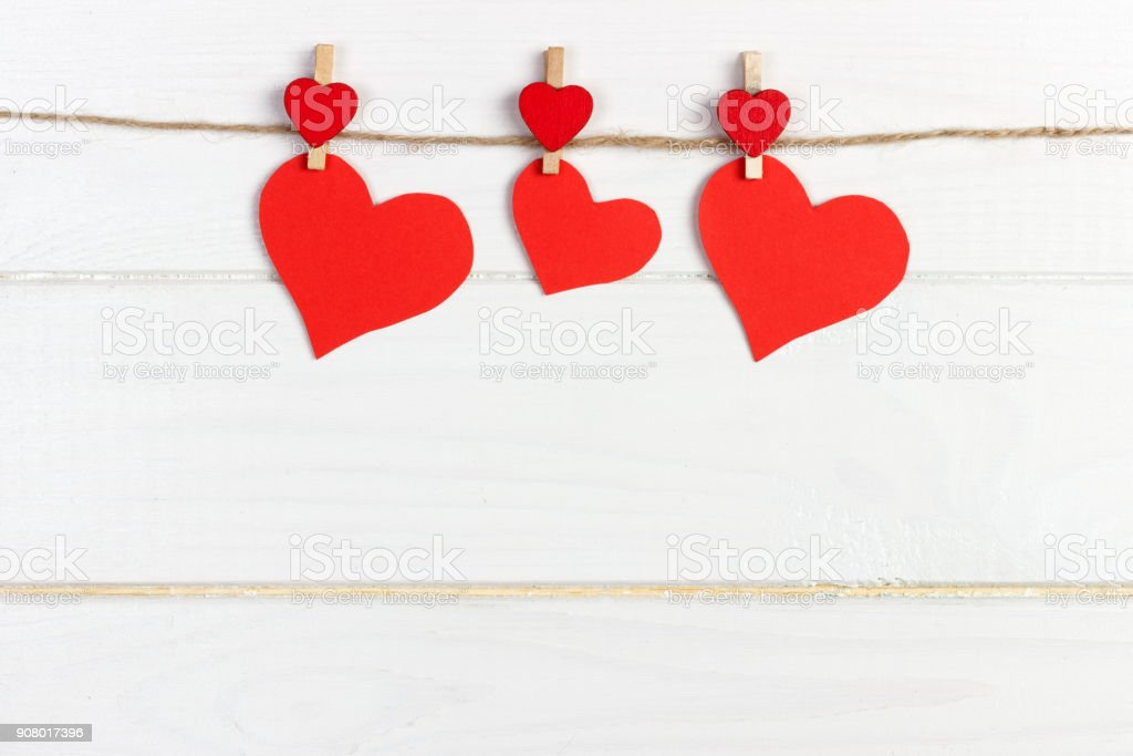Love paper heart on string. Valentine day concept, copy space stock photo
