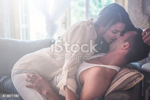 istock Love Passionate Couple at sofa bed 614971182