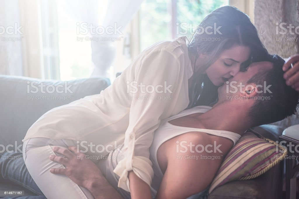 Love Passionate Couple at sofa bed stock photo