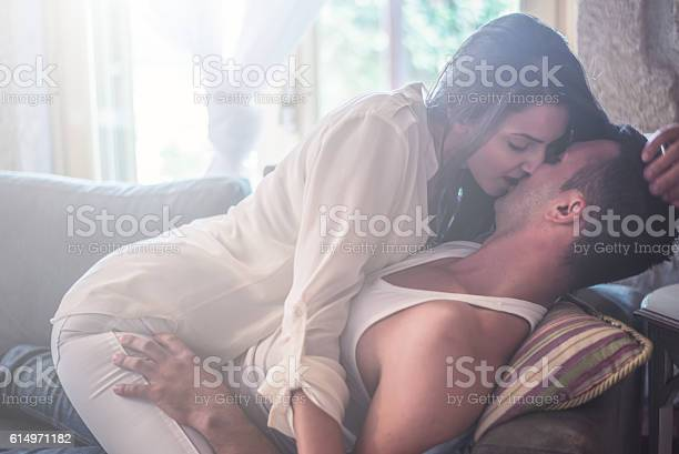 Love Couple have intimate moments at the sofa bed.