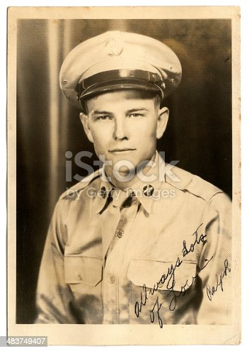 This an old family photo of my grandfather that he signed and sent to my grandmother when he was at war. It says