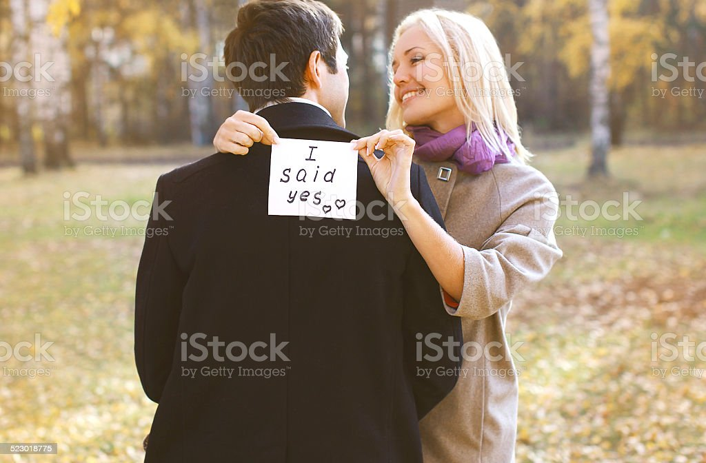 Love, relationships, engagement and wedding concept - man propos stock photo